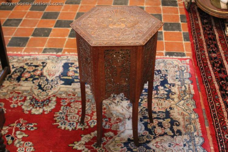 1 antique 6-angular table with wooden carvings,